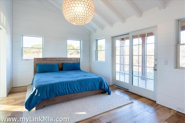 Bedroom with sliders to a private deck