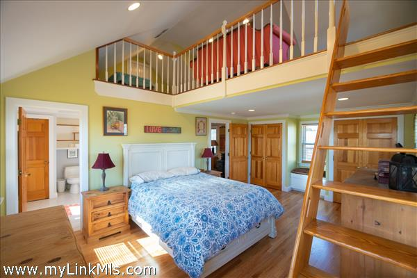 A sunny master suite with spacious loft above