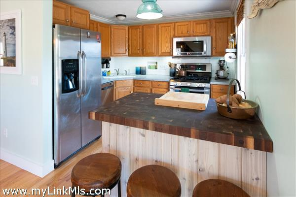 Kitchen with Boos block and stainless appliances