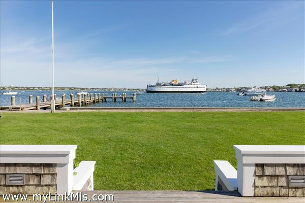 Large back yard with harbor views and private dock