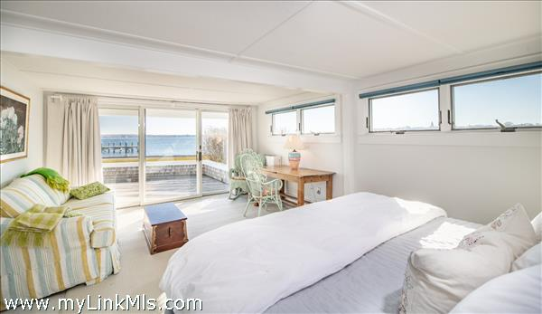 First floor master suite with harbor views and private deck access