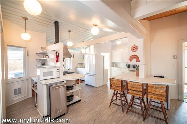 Spacious kitchen with stool seating