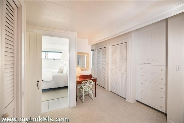 Master bedroom dressing area with built in storage and  many closets