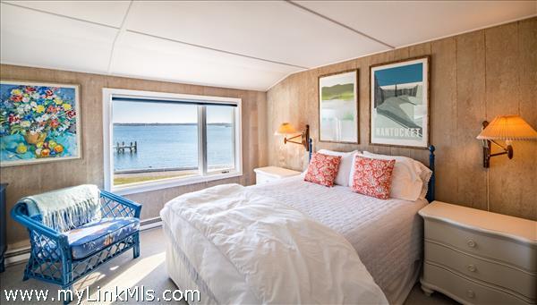 Second floor guest bedroom with harbor views