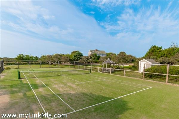 Fully enclosed Synthetic grass tennis court