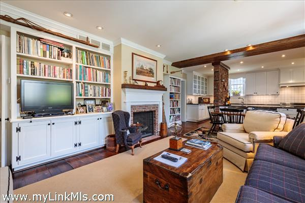 Keeping room with fireplace and built in bookshelves