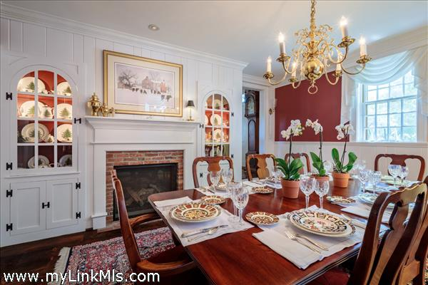 Dining room with two cabinets with interior lighting
