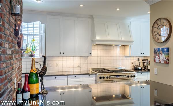 Chef's kitchen with black granite countertops