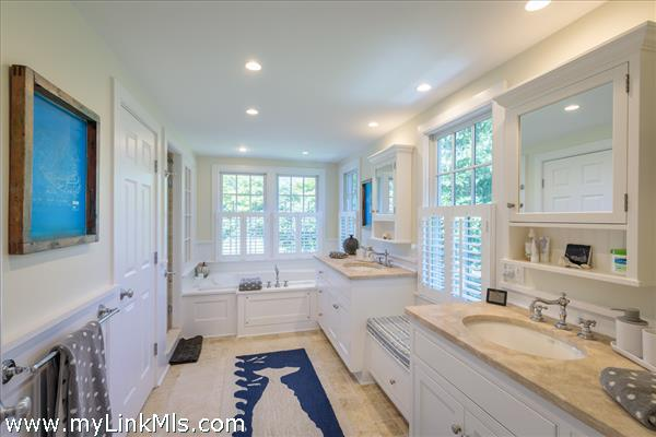 Ensuite master bath with jacuzzi tub and double vanity sinks