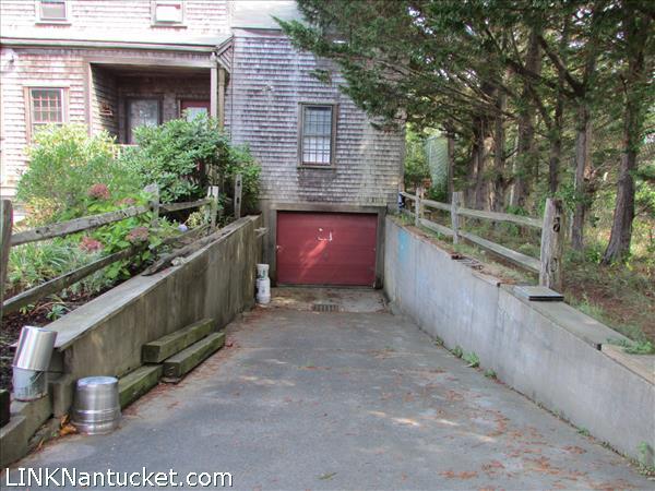 Ramp to under ground garage, basement workshop.