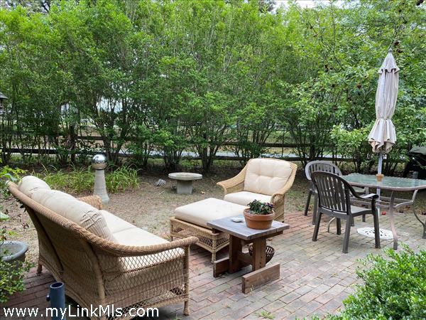 Outdoor Patio behind building on Surfside Road side.
