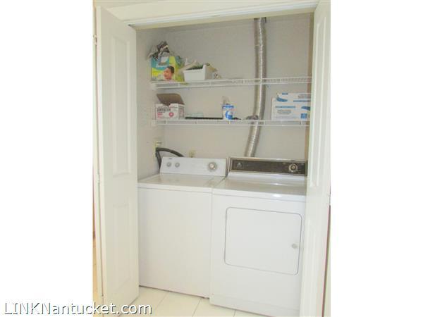 Laundry Closet in kitchen Apt. B