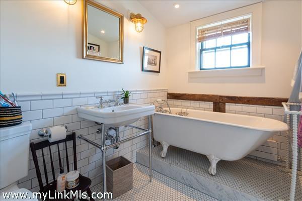 Master bath with clawfoot tub