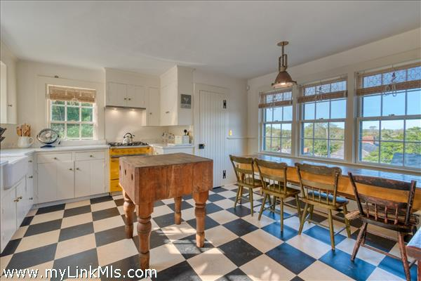 Kitchen with butcher block island before cathedral ceilings (2021)