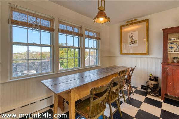 Kitchen table with sunset views before cathedral ceilings (2021)