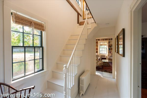 Front entry with stairs to second floor looking through to family room