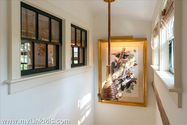 Stairwell with natural light - interior windows to master bedroom