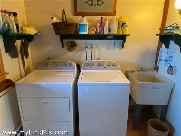 laundry area on first floor by garage and outdoor shower access.