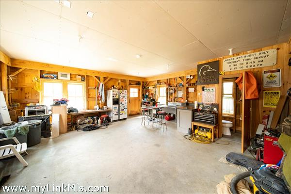 Heated garage floor plus a half bath.