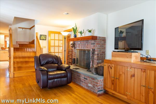 Den with Fireplace and Stove