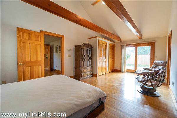 1st Floor Master Bedroom en-suite with French door to side deck