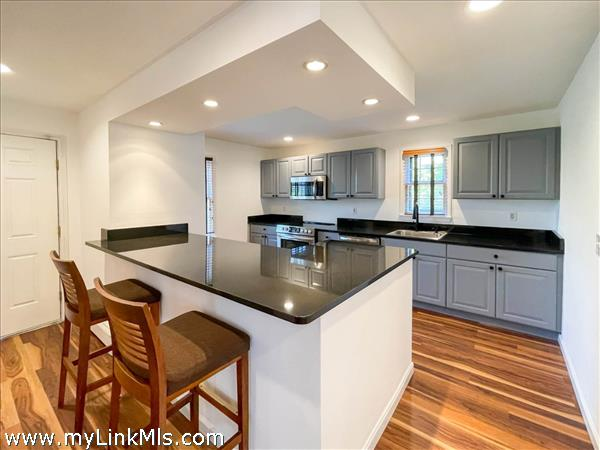 Front house. Remodeled kitchen with island.