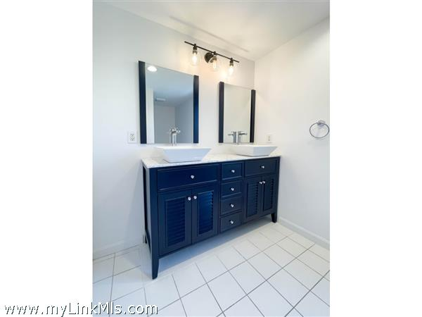 35 Macy renovated second floor bath with double vanity and vessel sinks.