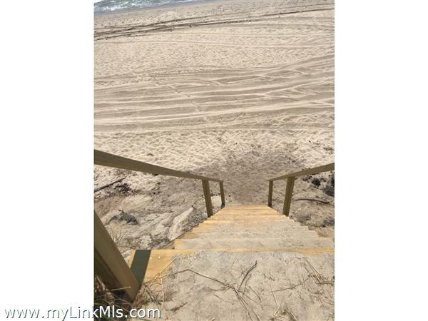 Stairs to beach from paper road
